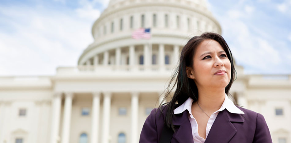 woman standing in front of united state capitol building