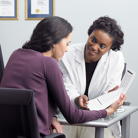 doctor explains to patient