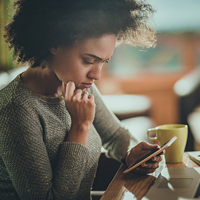 young woman on phone researching or thinking