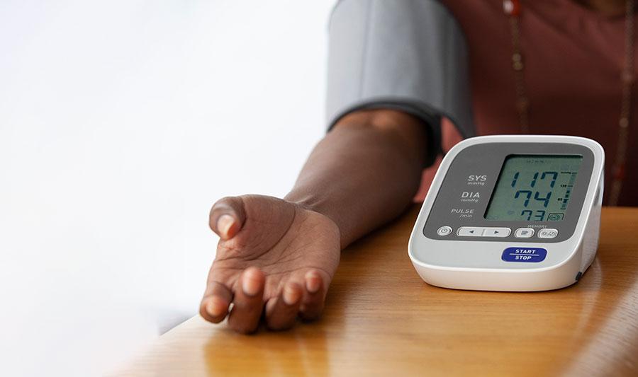 woman arm measuring blood pressure