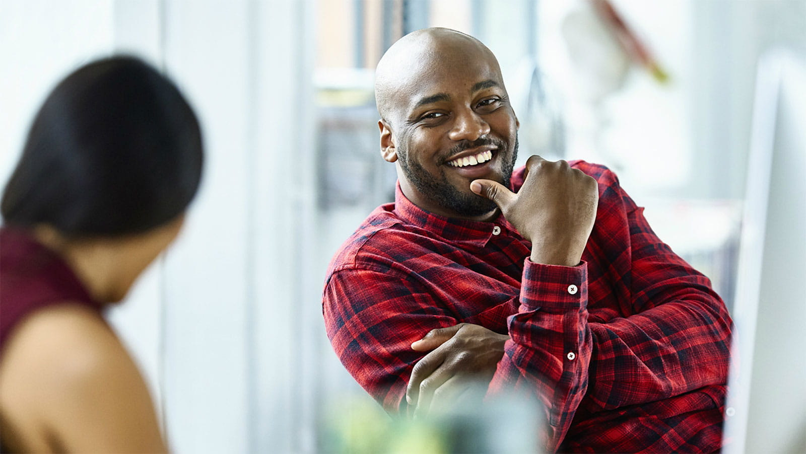 Smiling man making conversation in an office setting
