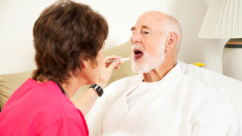 man having temperature checked