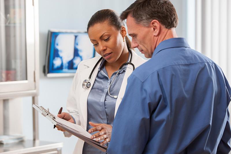 man talking to woman doctor