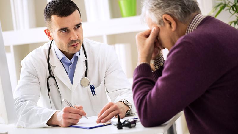 worried older man talking to doctor