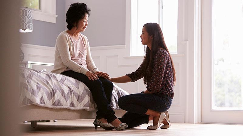 Daughter comforting mother