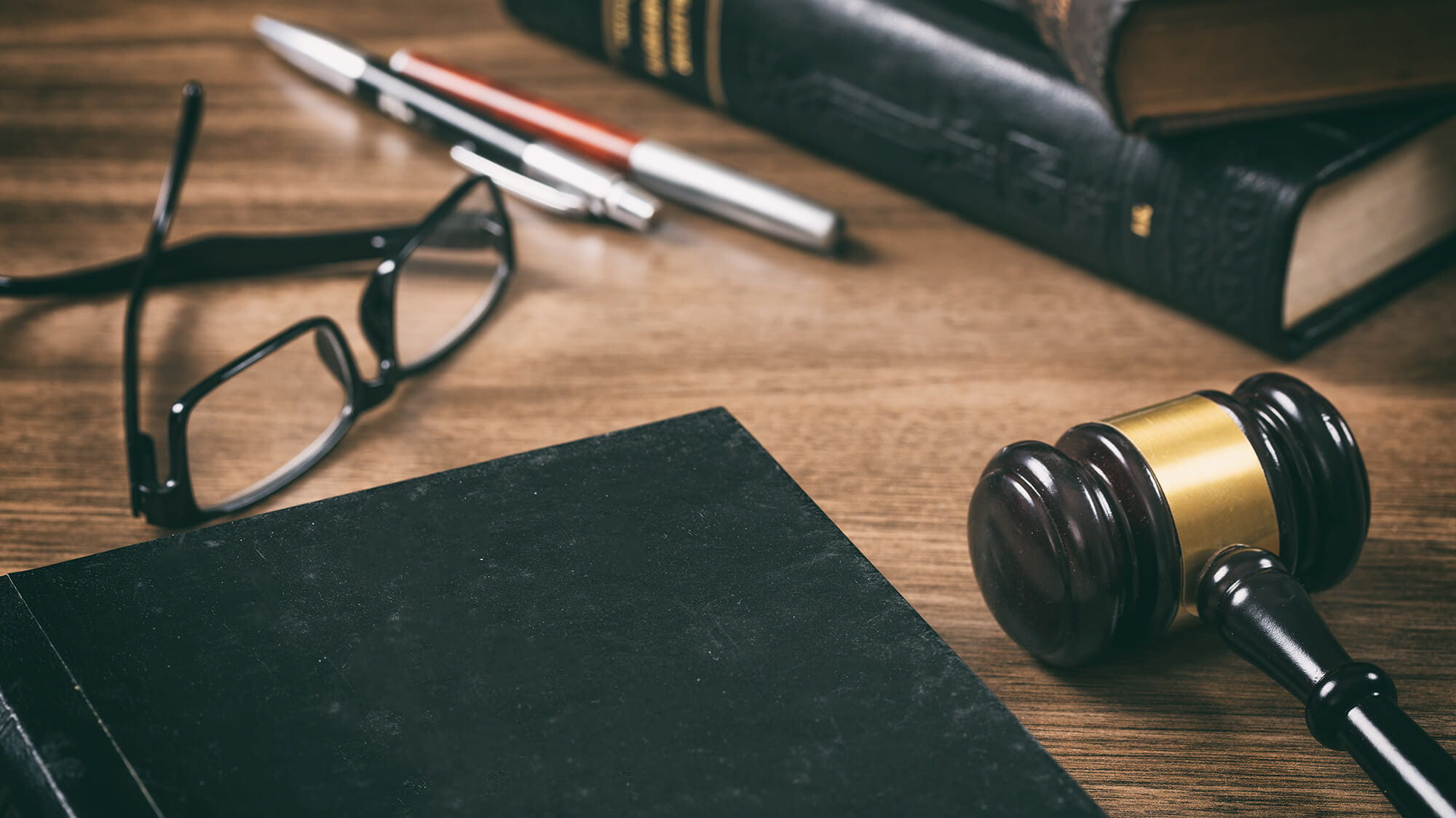 gavel, book and glasses