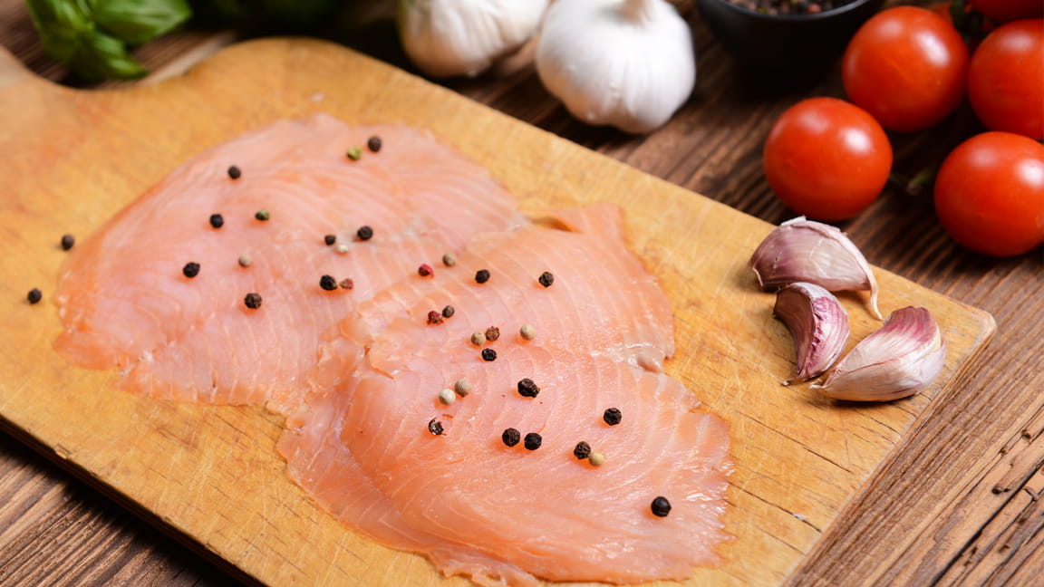 lean raw fish on cutting board