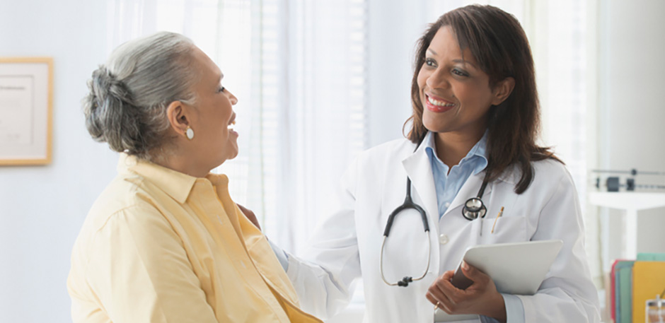 female patient speaking with female doctor