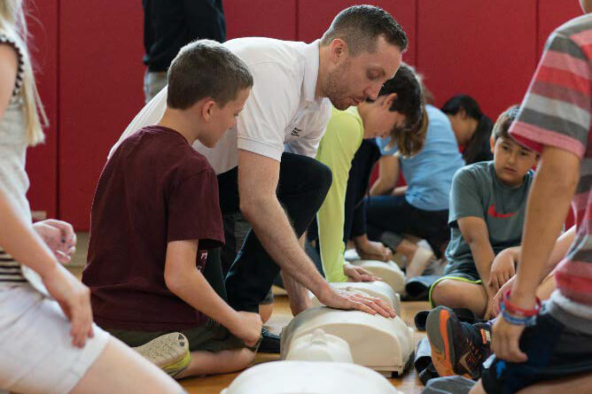 Lake Highlands training CPR in Schools 2