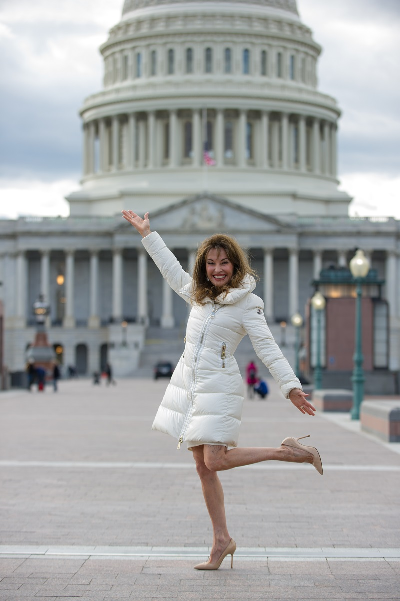 Actress Susan Lucci posing in front of the White House