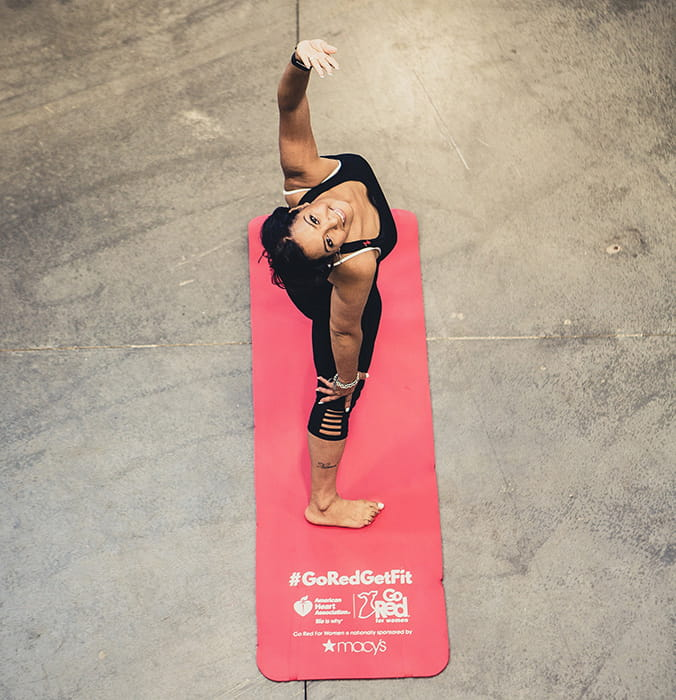 Go Red Get Fit woman in yoga class