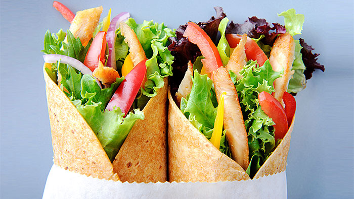 close up of two healthy chicken wrap