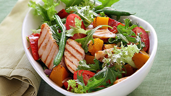 salad bowl of grilled chicken and peaches