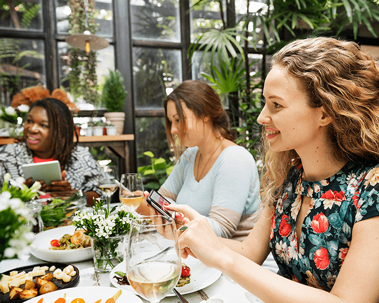 diverse group of women eating together