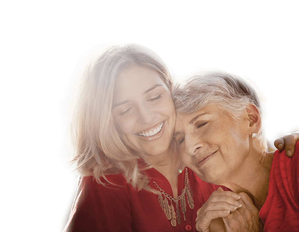 woman and her elderly mother hugging and smiling
