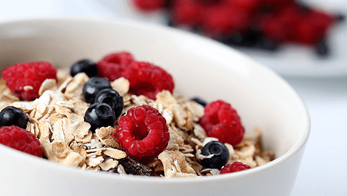 bowl of oatmeal with blueberries and raspberries