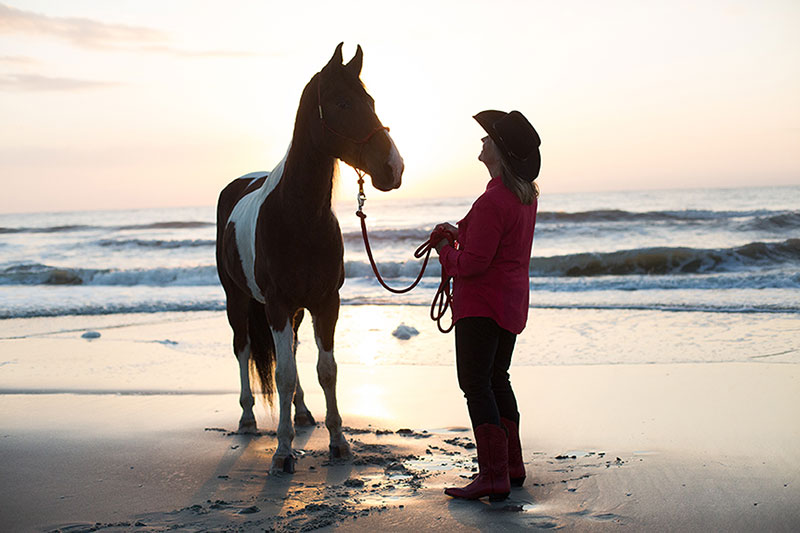 Debby and her horse at sunset - beach ride