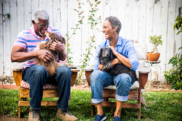 happy middle-aged couple with dogs