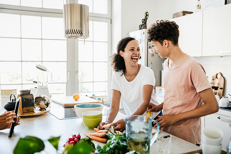mother and son cooking in kitchen