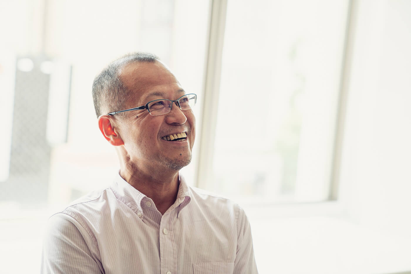 older asian man smiling laughing