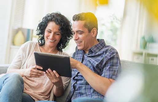 couple looking at something on tablet