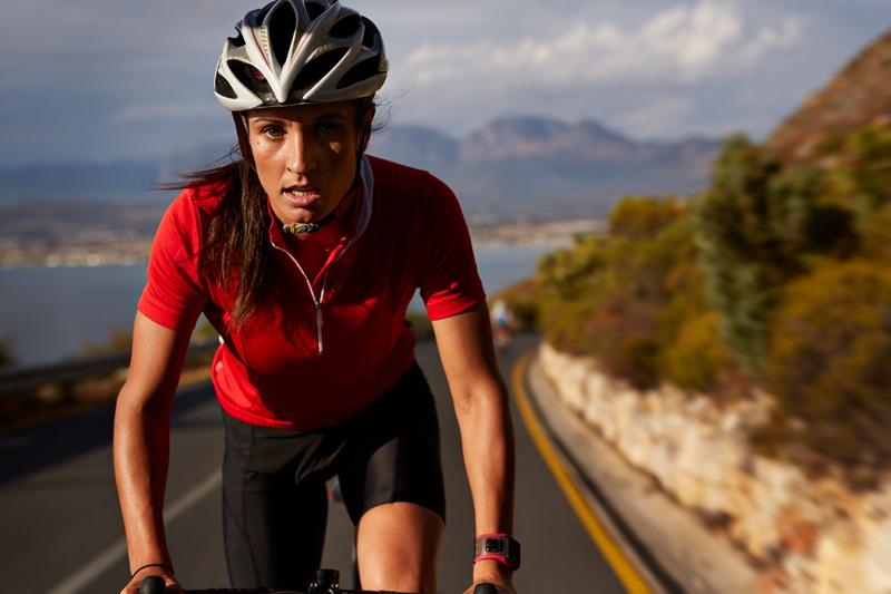 Female biking on highway
