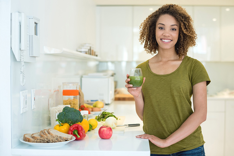 woman holding smoothie