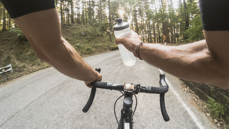 cyclist view drinking from water bottle