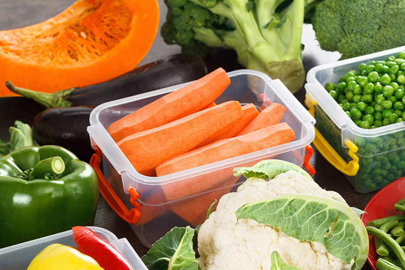Assorted vegetables in plastic containers