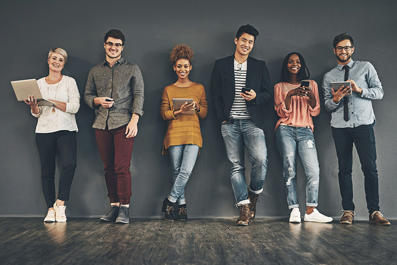 multiracial Millennials using laptops, tablets and phones