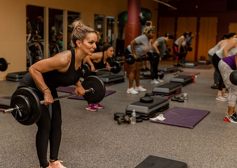 HealthWorks member Charivette Martinez participates in a strength-training class in 2019. (Photo by Kelsey Converse Photography)