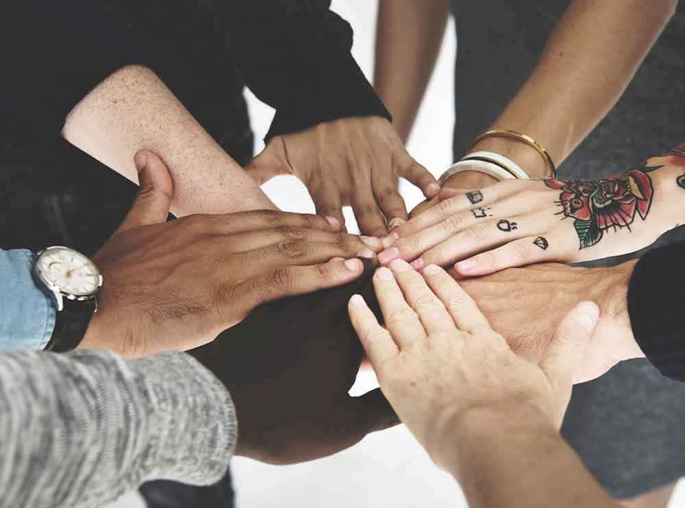 diverse group of overlapping hands