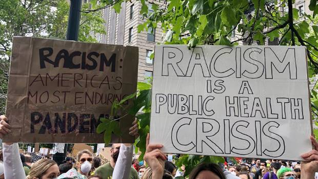 People holding stop racism signs