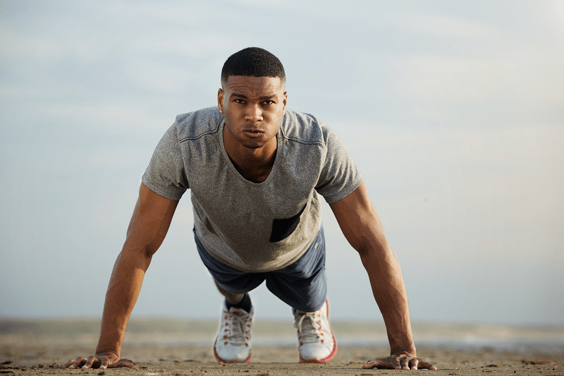 Young man exercising outside